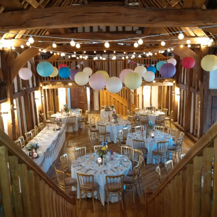 A bright and colourful canopy of paper lanterns with warm white festoon, perfect for a summer wedding, or at anytime of the year. #Lanternlove The Tudor Barn weddings #Festoon