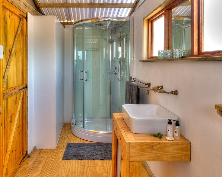 AfriCamps Glamping at Klein Karoo, South Africa. Glamping by AfriCamps never felt this good. Our shower comes equipped with a radio. Glamping done right at Klein Karoo.