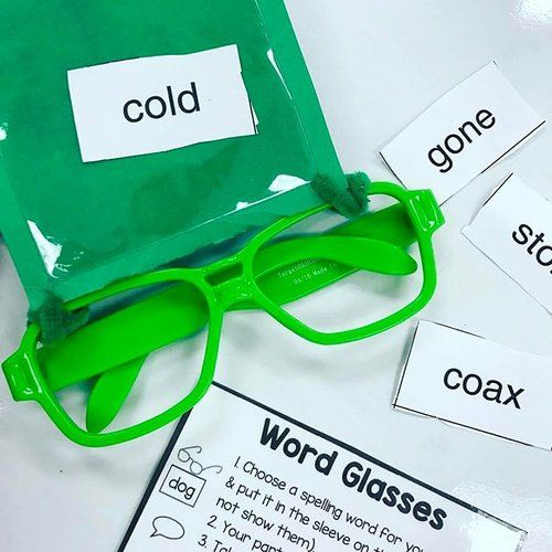 Word Glasses are one of our favorite word work tub activities. This comes from my Word Work Tubs activities product. Grab adhesive square labels from the target dollar spot and glasses from the party section. Put a piece of construction paper behind the square label and attach it with a pipe cleaner. Students put their spelling word in the pocket and play word glasses like the game Headbanz. 📲Link in my profile!😊✌🏻️