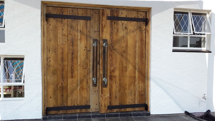 Large recycled oregon doors. Hand made strap projection hinges, handles 50mm copper pipe and galvanised tee pieces on flat metal back plate. Latch - large fridge door handle on the inside.