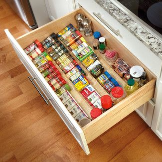 Features:  -Color: Natural.  -Constructed of UV cured maple.  -Organize spices.  -Can be trimmed to exact size with table saw.  -Perfect for spices or other household items.  -Drawer insert not adjust