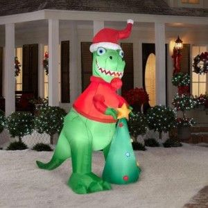 Christmas Inflatable 8 1/2 Ft Tall T-rex Air Blown Yard Prop T-Rex with Christmas tree will brings smiles to kids of all ages Self-inflates in seconds with built-in fan Weather-resistant material for outdoor use Internal lights create a glowing nighttime display 8.5 ft. for easy visibility