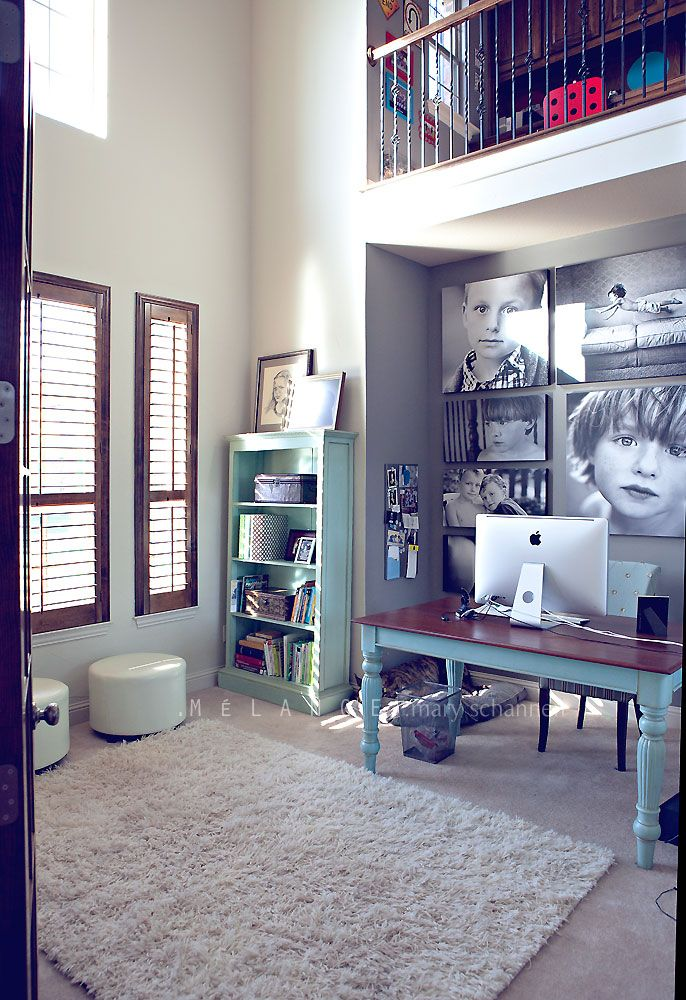 Home office by Mary Schannen. The canvas photos are large, 2 ft by 2 ft to 3 by 3.5 feet! Simple fabulous. Love her painted table with turquoise legs & stained wood top, along with the same blue on the bookcase. Melange Photography blog.