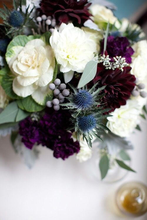 ivories with navy and a touch of deep plum which we'd sub for burgundy