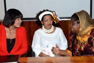 Prime Minister, the Most Hon. Portia Simpson Miller (left), listens keenly as Rastafari Millennium Council International Ambassador, Queen Mother Moses (right), makes a point, during the closing ceremony of the Kingston-leg of the Rastafari Studies Conference and General Assembly 2013, on August 15. At centre is Director, Centre for Gender and Development Studies: Regional Co-ordinating Unit, UWI, Professor Verene Shepherd. (Photo: Jamaica Information Service)