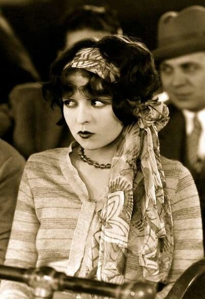 Clara Bow 1927; she came to personify the Roaring Twenties and is described as its leading sex symbol