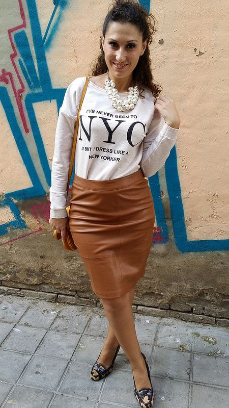 Graphic t and brown leather skirt