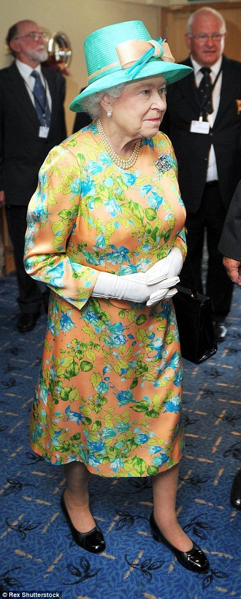 Crowning glory: The Queen goes all out at Brdo Castle for a State Banquet During State Visit to Slovenia, left, and goes floral in on the Scilly Isles in 2011.