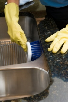 Cleaning stainless steel. For tougher jobs: mix 3 parts cream of tartar with 1 part hydrogen peroxide and then using a damp cloth, massage the mix into the surface. Let dry then wipe with a damp cloth. OR...1 part vinegar, 1 part hot water, 1/2 part baking soda. Scrub mixture into surface using a damp sponge or cloth. Rinse well then dry with a cloth.