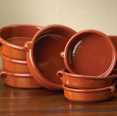Cazuelas Dishes. Flat-bottomed cazuelas are the ultimate stove-to-table cookware. The pots, ceramic with a glazed interior, are used to make rice and sauces such as mole poblano. Opt for quality: Cheaper ones may be painted with lead-based glazes.