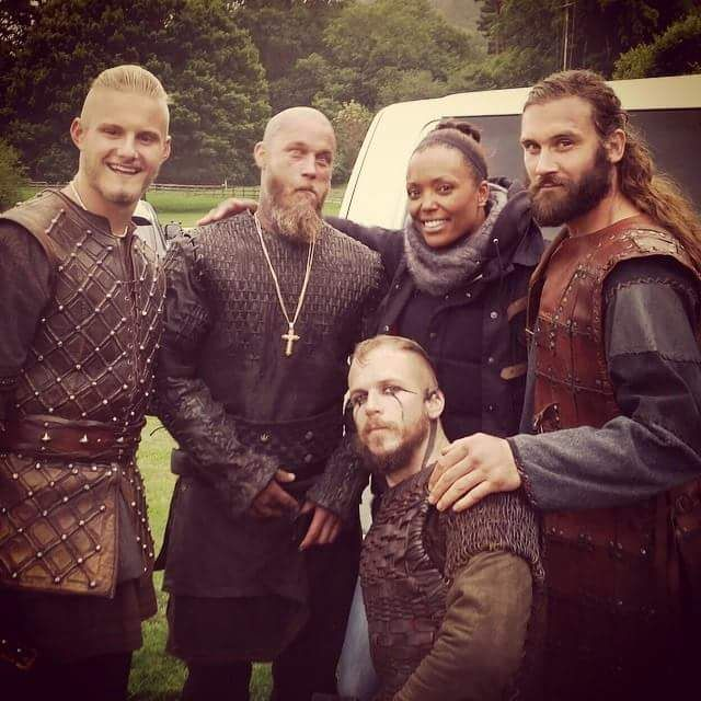 Travis Fimmel, cast members & Aisha  Tyler on the set of Vikings