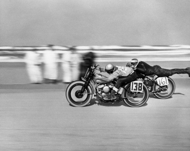 """Norman Teleford (No. 161) streamlines himself during a motorcycle race at Daytona Beach, March 1948."" (Joseph Scherschel—Time & Life Pictures/Getty Images): Motorcycles, Bike, Daytona Beach, Cafe Racer, Photo, Daytona 1948, Motorcycle Madness"