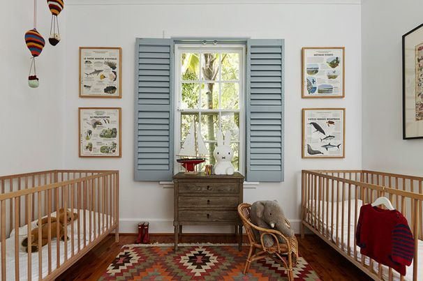 This nursery is a master class in how to use accent colors effectively. White walls and warm wooden furniture sit beautifully alongside a patterned kilim rug and powder blue shutters. Touches of fire engine red add glorious contrast to complete this striking scheme with unisex appeal. For a new look, all you have to do is swap in different accessories.