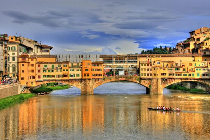 Walk across Ponte Vecchio Bridge, Florence, Italy - TripBucket