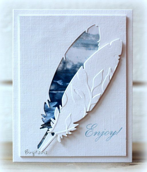 handcrafted card from Rapport från ett skrivbord: CAS-ual Friday 69 ...card featuring a feather die cut  ... main panel with negative space backed with encaustic painting in blues ... die cut feather is embossed with leaves and popped up covering an edge of the negative space ... beautiful ... luv it!!