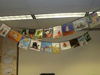 Book bunting! I made mine by photocopying the cover x2 and sticking them back to back, sandwiching ribbon between the two, before leaving a save and sticking on the next one.  Very effective in the cloakroom area and a conversation starter between children and adults alike.