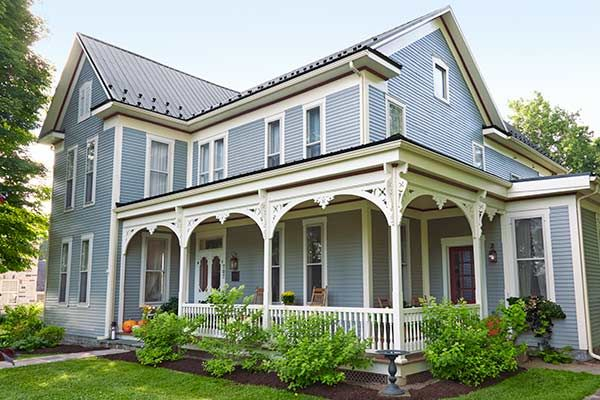 Check out the meticulous re-creation of the original wraparound porch on these homeowners' circa-1874 Folk Victorian. And get the whole story here.