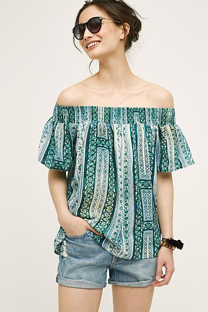 LOVE the pattern, off the shoulder, and breezy sleeves on this top.