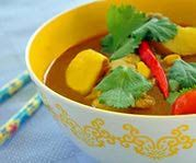 Thai Yellow Curry Chicken with Potatoes, Fresh Coriander, and Chili