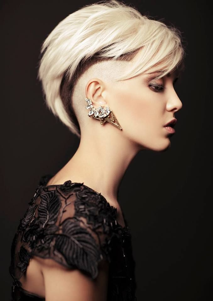 now, this is something I would do. Shave the sides completely, buzz the middle layer, and keep the top a decent length. Style it back and it's edgy, style it straight, and it's pretty and clean.