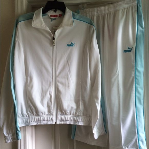 Puma Jogging Suit NWTs...2 piece white/2 different shades of blue Puma jogging suit, the pant is Capri length w/2 front pockets..Jacket is a Medium & pant is a Small.... Puma Jackets & Coats
