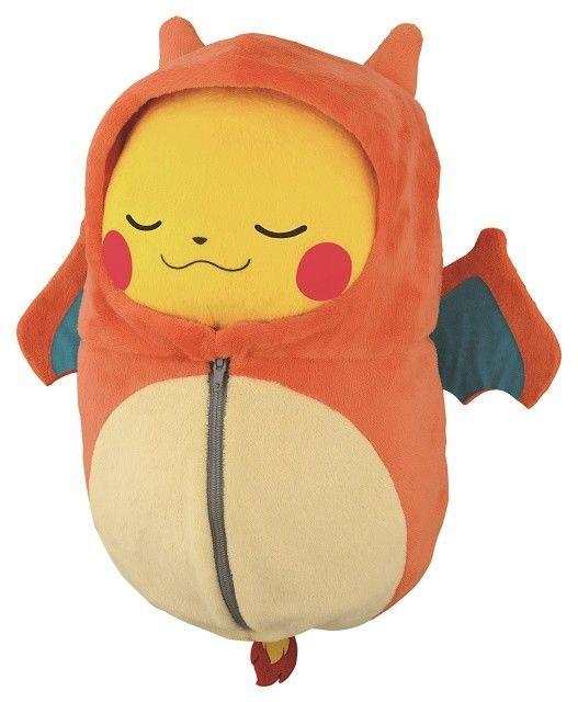 So cute - pikachu wrapped up in Charizard sleeping bag <3