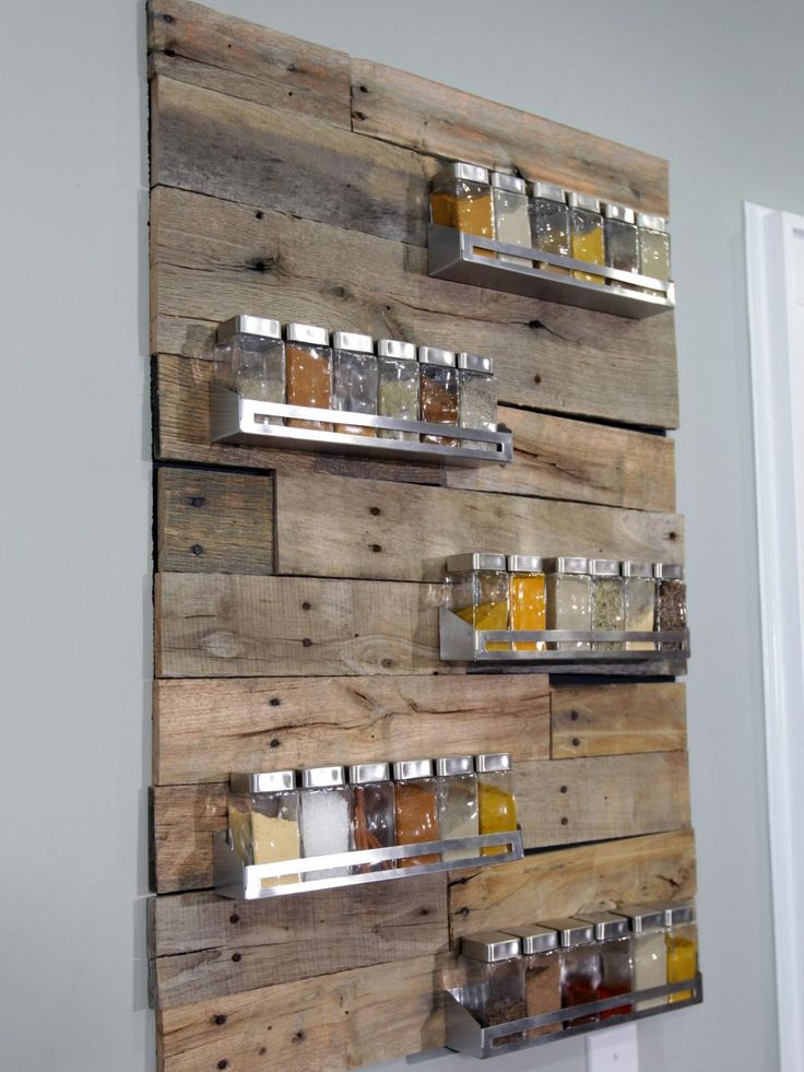 Most of us hide our mismatched spices in a cabinet until it's time to cook. Anthony Carrino and John Colaneri of HGTV'sKitchen Cousinshave a solution to turn your spices into a unique piece of artwork. Slabs of reclaimed wood were cut to size and nailed to the wall, and then various metal holders were added to hold 30 different spices in matching canisters.