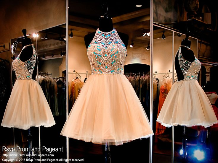 This beautiful short dress has a gorgeous halter neckline covered with aqua beading, an open back and a nude full tulle skirt. Perfect for homecoming or sweet sixteen and it's at Rsvp Prom and Pageant, Atlanta Prom Dresses!