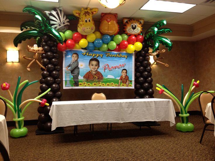 Jungle theme balloons.     Balloon flowers on floor