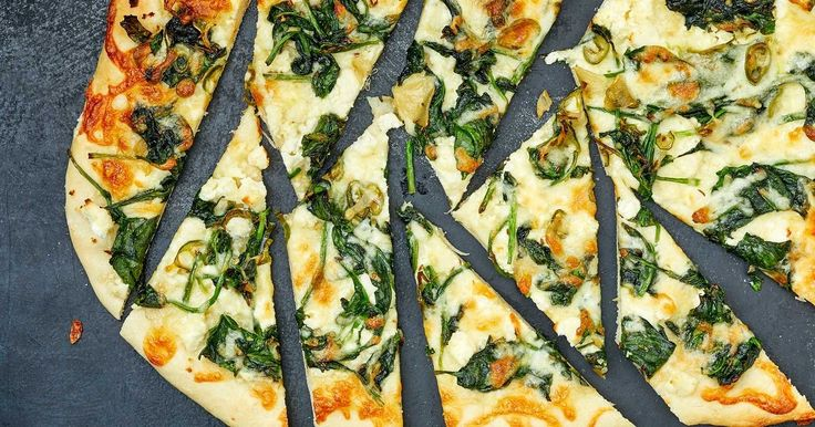 Enjoy a slice of homemade saag pizza, topped with crumbly paneer cheese, spinach and mozzarella.