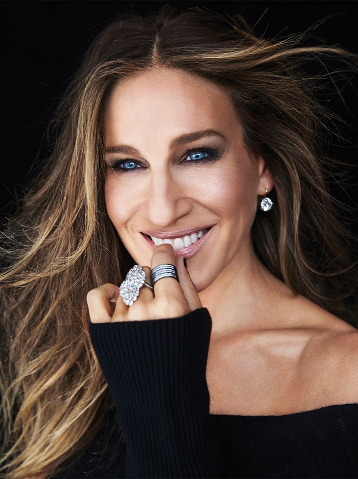 Rag & Bone sweater, $275. Fred Leighton diamond drop earrings and diamond cluster ring, price upon request. Fallon triple hinge ring, $315.