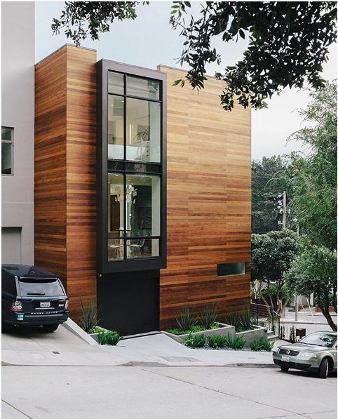 We love these glossy red wood planks that clad this San Fransican home by George Bradley Architect