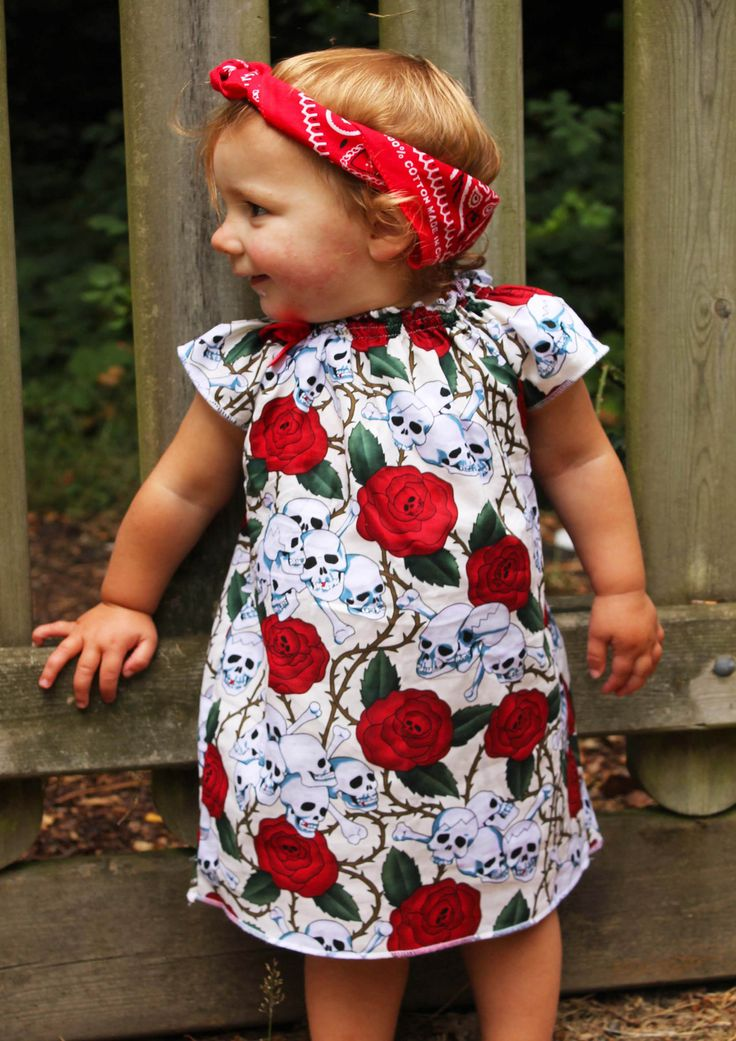 Skull & Roses Rockabilly Baby Girl Dress The design of this awesome girls rockabilly style dress means when it's been outgrown as a dress it can still be worn as a tunic style top, super cute! Skull & roses cream cotton print gorgeous rockabilly baby dress Elasticated neckline Stunning flutter sleeves Cute red bow feature, 'cause every girl …