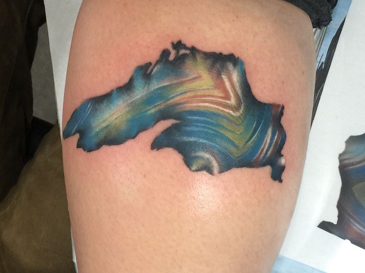 Lake Superior with an agate-esque twist - Kyle James Benchmark Tattoo Duluth MN