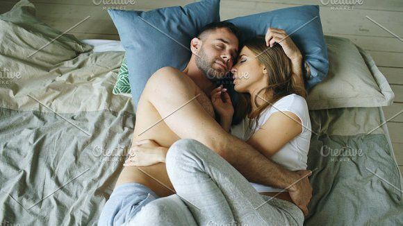 Young Beautiful And Loving Couple Kissing On Bed In The Morning Romantic