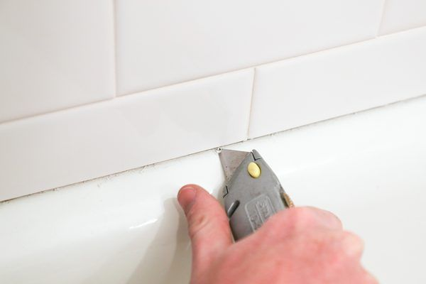 Mold almost always poses a problem in the bathroom because of the moisture there, but it's a particularly pernicious one when it grows behind bathtub caulking. Mold causes unsightly blackening that can make the bathroom appear dirty even when you clean regularly, and it can even cause [health...