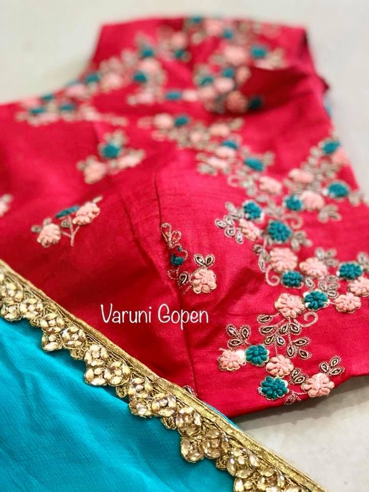 Beautiful powder blue color designer saree and red color designer blouse with floret lata design hand embroidery thread work. Lovely detailing blouse from Varuni Gopen. 04 November 2017