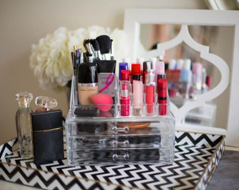 Arrange your makeup in lucite desk organizers so you can see everything that's stowed away.
