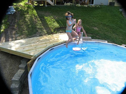 How to build small deck for above ground pool on - Building a swimming pool on a slope ...