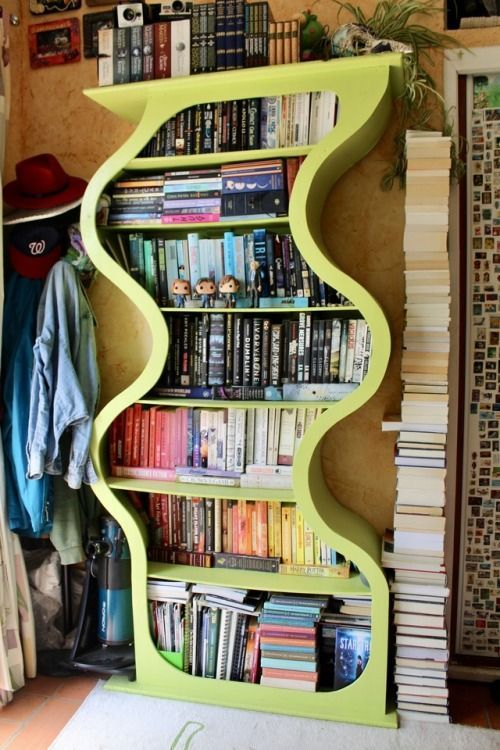A real cool bookshelf...and still a sky-high pile of books next to it - because there's no such thing as to many books!