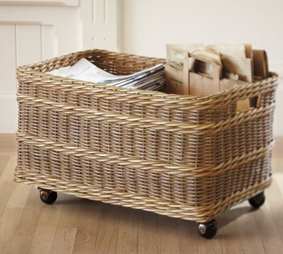 Pretty and practical way of storing recycling. Rolling wheels makes it easy to move about. Jacquelyne Recycling Bin Basket | Pottery Barn