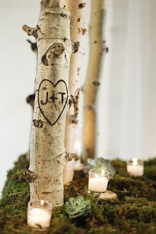 IF YOU'RE HAVING A RUSTIC-STYLE WEDDING, CARVE YOUR INITIALS INTO BRANCHES.