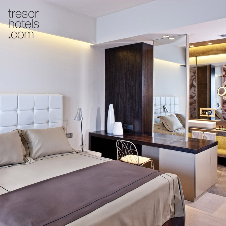 Trésor Hotels and Resorts_Luxury Boutique Hotels_#Greece_ All of the rooms at #Aqua #Blu express the magic of ample natural light which keep streams inward from the massive floor-to-ceiling windows during the day and gives way to the hidden lighting after sunset. Rooms and Suites have been colored in deep earthy tones and all have oak floors.