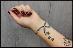 laurelarth tattoo tatouage région lyon bracelet étoile omega vert bleu