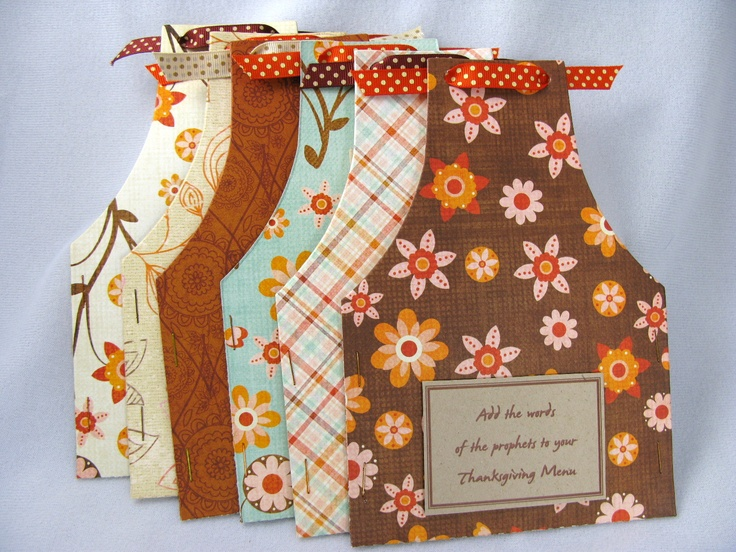 Love these apron shaped pocket pouches cut out of scrapbook paper. This would be easy to do.