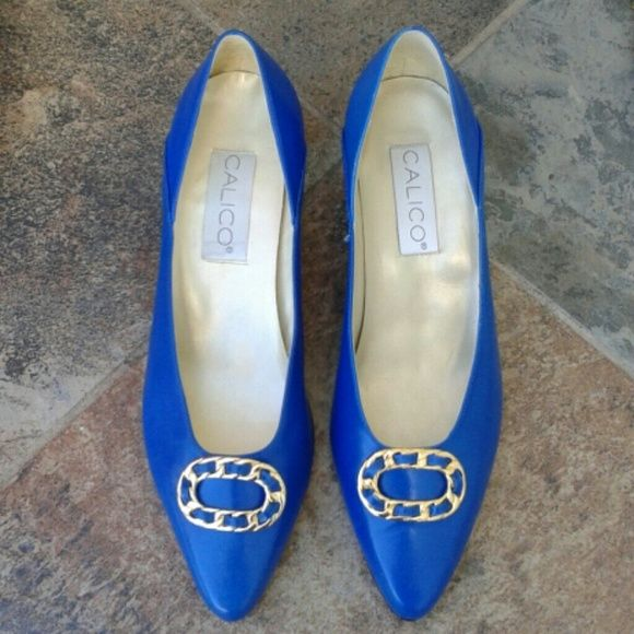 Blue Calico Vintage Pumps - Vintage blue ladies pumps - Gorgeous shade of blue - Slight signs of wear - Gold metal trim  - Bottoms of heels newly replaced with rubber instead of plastic - Bottoms of heels sanded by cobbler to remove any markings - Made in Brazil - Genuine leather upper - Manmade soles calico Shoes Heels