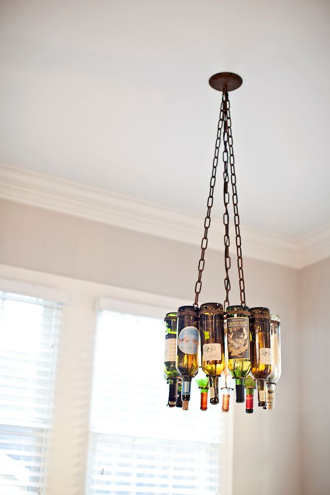 This light fixture made with recycled wine bottles is so clever! Adds an element of style and color!