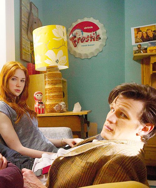 If you look in the background to the right top corner, you see a picture of Rory, Amy, and the doctor