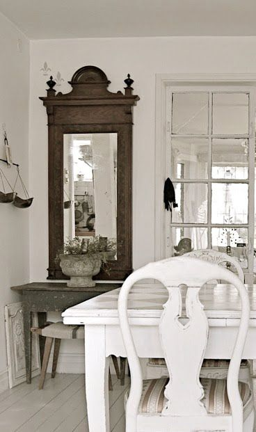 Love the primitive table and mirror with cement urn
