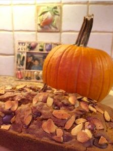Pumpkin Bread with Dark Chocolate Chips and Almonds- 150 calories per muffin. Can be made with whole wheat, almond milk and applesauce.